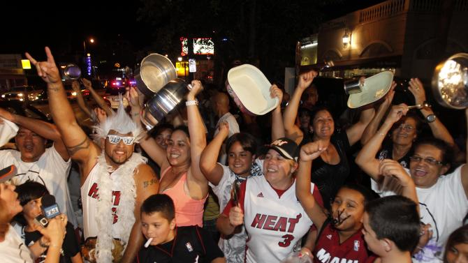 Miami Heat fans celebrate the Heat win against Oklahoma City Thunder in the Little Havana area of Miami, Friday, June after Game 5 of the NBA finals basketball series against the Oklahoma City Thunder, Friday, June 22, 2012, The Heat won 121-106 to become the 2012 NBA Champions. (AP Photo/Alan Diaz)