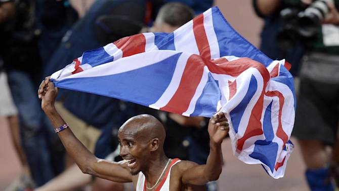 In this Saturday, Aug. 4, 2012 photo, Britain's Mo Farah celebrates winning gold in the men's 10,000-meter final during the athletics in the Olympic Stadium at the 2012 Summer Olympics, London. Farah _ who moved to Britain as a child from his native Somalia and grew up in the British sport system _ was treated as a national hero after he won the 10,000 meters. (AP Photo/Martin Meissner)