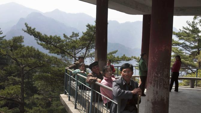 In this April 20, 2011 photo, hikers rest at a small pagoda along a trail on Mount Myohyang in North Korea. (AP Photo/David Guttenfelder)