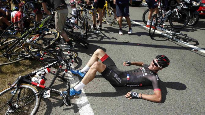 Bora-Argon 18 rider Dominik Nerz of Germany lies on the ground after a fall during the third stage of the 102nd Tour de France cycling race from Anvers to Huy