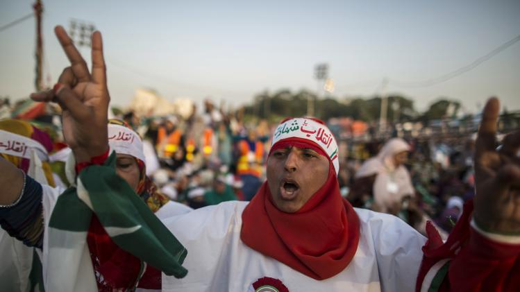 """A supporter of Tahir ul-Qadri, Sufi cleric and leader of political party Pakistan Awami Tehreek (PAT), chants slogans against Prime Minister Nawaz Sharif in front of the Parliament house building during the """"Revolution March"""" in Islamabad"""