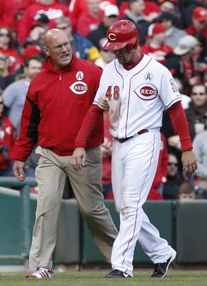Cincinnati Reds left fielder Ryan Ludwick (48) is helped off the field after dislocating his shoulder in the third inning of a major league baseball game against the Los Angeles Angels, Monday, April 1, 2013, in Cincinnati. (AP Photo/David Kohl)