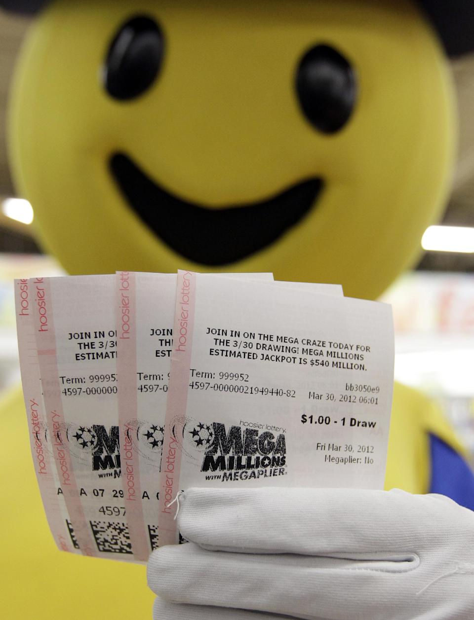 Mega Millions Lottery tickets that were given away to the first 540 people are displayed by the Hoosier Lottery's Mega Millions mascot at a store in Zionsville, Ind., Friday, March 30, 2012. The Mega Millions Lottery jackpot has reached more than $600 million. (AP Photo/Michael Conroy)