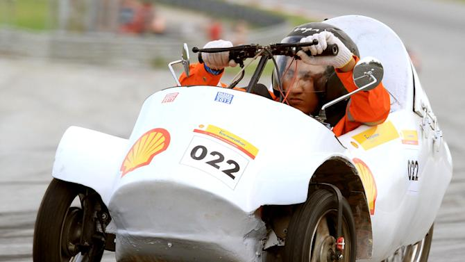 COMMERCIAL IMAGE - In this photo released by AP Images for Shell, The #22 Team BITS, Gasoline Prototype, from Birla Institute of Technology and Science(BITS) in India turns a lap on day four of the Shell Eco-marathon Challenge Asia at Sepang International Circuit in Kuala Lumpur, Saturday, July 7, 2012. Students from Asia and the Middle East have come together to compete in the four-day event. (Peter Lim/AP Images for Shell)