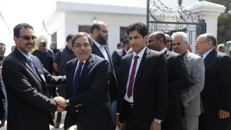 Ali Tarhouni, one of the members of constituent body drafting Libyan constitution, greets colleague, ahead of first meeting to draft Libyan constitution in Al-Bayda