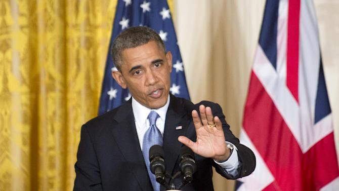 President Barack Obama gestures during a joint news conference with British Prime Minister David Cameron, Monday, May 13, 2013, in the East Room of the White House in Washington, where they talked about subjects ranging from Syria's civil war to preparations for a coming summit in Northern Ireland. (AP Photo/J. Scott Applewhite)