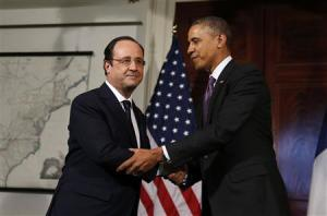 U.S. President Barack Obama and French President Francois Hollande shake hands in Charlottesville