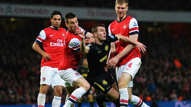 Wigan's Callum McManaman is crowded out against Arsenal (Getty)