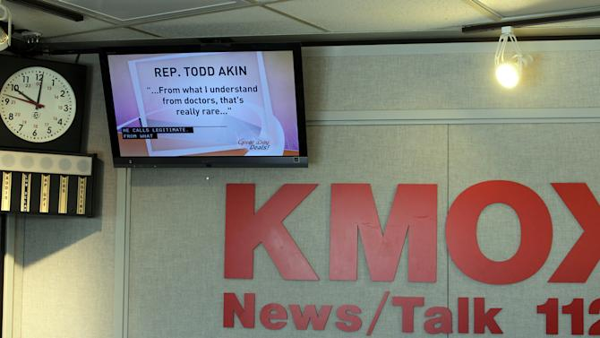 "FILE - In this Aug. 20, 2012 file photo, a televison monitor displays comments from Rep. Todd Akin's at studios of KMOX in St. Louis.  Akin was scheduled to be on the Charlie Brennan show, but didn't come in or call the station.  Until this week, Rep. Todd Akin was virtually unknown beyond his district, associated more with his deep religious convictions than any legislative achievements. Long before his comments about women's bodies and ""legitimate rape"" made him a flashpoint in the fall campaign, this congressional backbencher was a favorite among home-schooling organizations and conservative church groups. (AP Photo/St. Louis Post-Dispatch, J.B. Forbes) EDWARDSVILLE INTELLIGENCER OUT; THE ALTON TELEGRAPH OUT"
