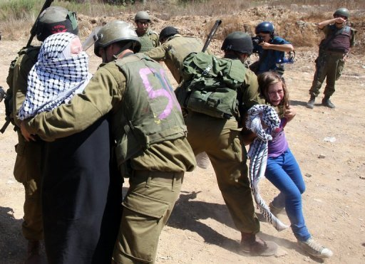 A Palestinian girl cries as Israeli soldiers detain her mother at a demonstration in the West Bank village of Nabi Saleh
