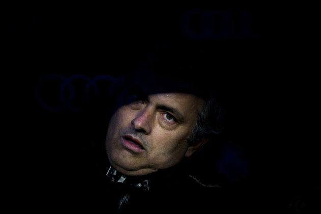Real Madrid's coach Jose Mourinho from Portugal looks up before the start of his Spanish La liga soccer match against Barcelona in the Bernabeu stadium in Madrid, Saturday, Dec. 10, 2011. Barcelona wo