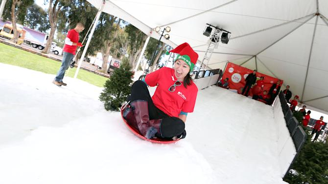 "IMAGE DISTRIBUTED FOR MATTEL - Mattel employees and Los Angeles school children enjoy a ""Winter Wonderland"" featuring 220 tons of snow at Mattel's Southern California headquarters on Thurs., Dec. 13, 2012 in El Segundo, Calif. (Photo by Casey Rodgers/Invision for Mattel/AP Images)"