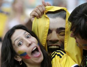 Colombian supporters hold up a photo of Uruguay's…