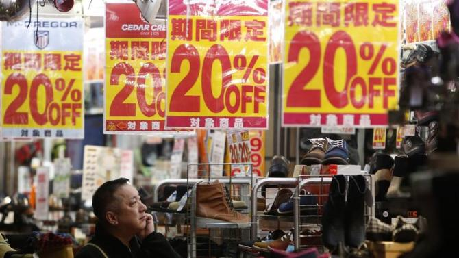File photo of a man looking at items in a shoe store at a shopping district in Tokyo