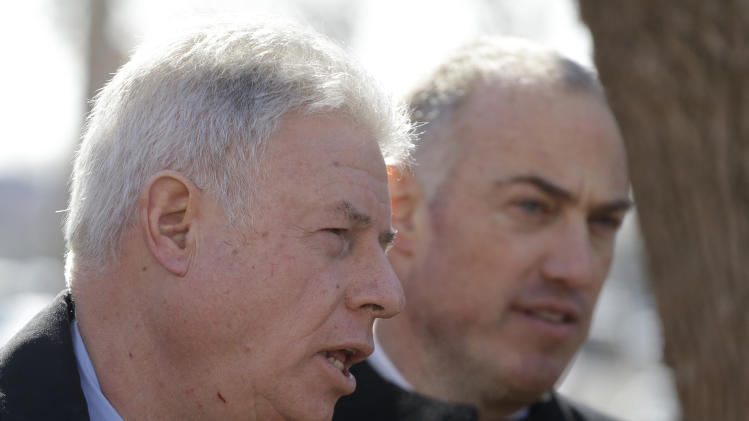 Retired judge Daniel Locallo, left, and defense Lawyer for Drew Peterson Steve Greenberg speak with the media as they leave the Will County Courthouse for lunch, Wednesday, Feb. 20, 2013, in Joliet, Ill., during the second day of a hearing in the former suburban Chicago police officer's request for a new trial. During the hearing Locallo testified as the defense sought to bolster arguments Peterson deserved a retrial on charges he murdered his third wife, Kathleen Savio. Peterson's attorneys contend his former lead trial attorney, Joel Brodsky, botched his case. Locallo told the judge that Brodsky made a major mistake by calling one witness whose testimony badly backfired on the defense. (AP Photo/M. Spencer Green)