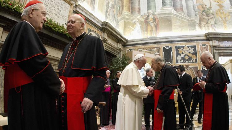 Pope Francis greets cardinals during audience for Christmas greetings to Curia in Clementina hall at the Vatican