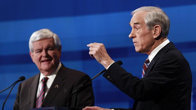 Rep. Ron Paul, R-Texas, speaks as former House Speaker Newt Gingrich listens at the South Carolina Republican presidential candidate debate in Myrtle Beach, S.C., Monday, Jan. 16, 2012. (AP Photo/Charles Dharapak, Pool)