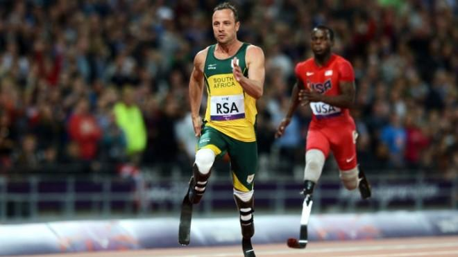 Oscar Pistorius of South Africa finishes with gold in the Men's 4x100m relay T42/T46 Final at the London 2012 Paralympic Games.