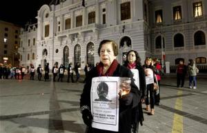 Relatives of victims tortured and executed during the rule of General Pinochet, take part in a rally marking military coup in front of a Chilean Navy building in Valparaiso city