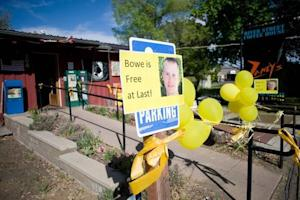 Signs of support with images of U.S. Army Sergeant Bergdahl are displayed outside Zaney's coffee shop in Hailey