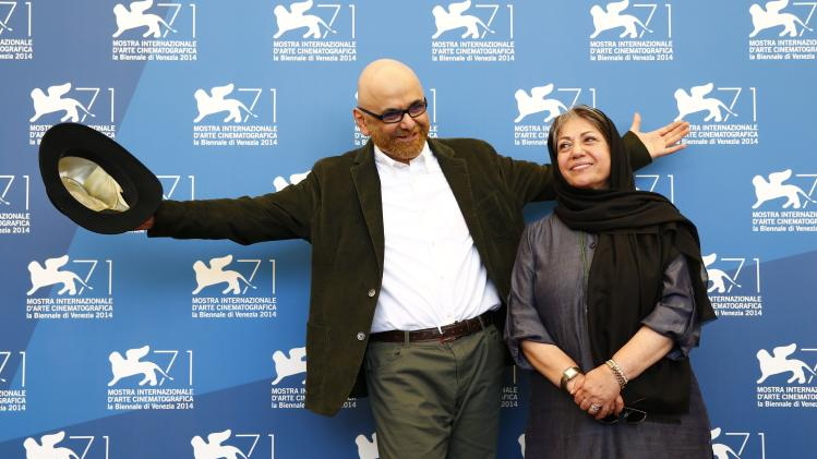 """Director Rakhshan Bani-Etemad and actor Habib Rezaei pose during the photo call for the movie """"Ghesseha"""" at the 71st Venice Film Festival"""