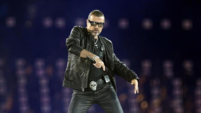 George Michael performs during the Closing Ceremony at the 2012 Summer Olympics, Sunday, Aug. 12, 2012, in London. (AP Photo/Charlie Riedel)