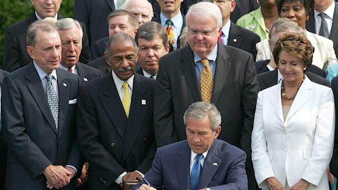 FILE - This July 27, 2006 file photo shows President George W. Bush signing legislation for a 25 year extension of the Voting Rights Act on the South Lawn of the White House in Washington. The Obama administration and civil rights groups are defending a key provision of the landmark Voting Rights Act at the Supreme Court by pointing reformed state, county and local governments to an escape hatch from the law's most onerous aspects. Wednesday, Feb. 27, 2013, the Supreme Court will hear arguments in the case, which is among the term's most important. From left are Sen. Arlen Specter, R-Pa., Rep. John Conyers, D-Mich., Rep. James Sensenbrenner, R-Wis., and Rep. Nancy Pelosi, D-Calif. (AP Photo/Ron Edmonds, File)