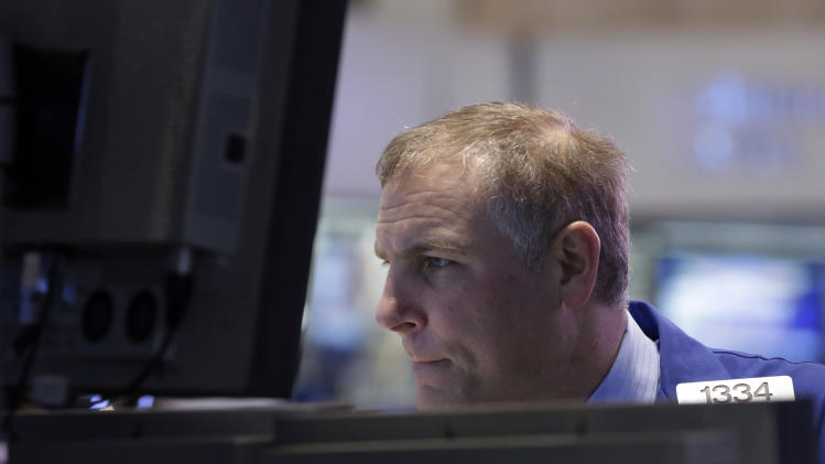 Specialist Geoffrey Friedman works on the floor of the New York Stock Exchange Monday, March 25, 2013. U.S. stock markets opened higher after Cyprus clinched a last-minute bailout that saved it from bankruptcy. (AP Photo/Richard Drew)
