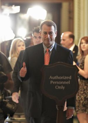 House Speaker John Boehner of Ohio gives a thumbs-up as he leaves the House Chamber on Capitol Hill in Washington, Friday, July 29, 2011, after House passage of his debt-limit legislation that was rewritten overnight to win the support of conservative holdouts.  (AP Photo/J. Scott Applewhite)