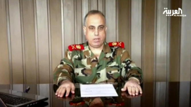 "In this image made from video broadcast on Al Arabiya TV late Tuesday, Dec. 25, 2012, Syrian Maj. Gen. Abdul-Aziz Jassem al-Shallal makes remarks saying he is joining ""the people's revolution.""  The general who heads Syria's military police has defected and joined the uprising against President Bashar Assad's regime, one of the highest walkouts by a serving security chief during the country's 21-month uprising, a pan Arab TV station has reported.(AP Photo/Al Arabiya via AP video)TV OUT NO SALES"