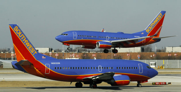 "<p>               FILE - In this Feb. 9, 2012 file photo, a Southwest Airlines Boeing 737 waits to take off at Chicago's Midway Airport as another lands. Southwest Airlines' attempt to thank its online friends with a half-price ticket sale has backfired with customers inadvertently being billed multiple times, not feeling the ""luv.""  Airline spokeswoman Ashley Dillon on Saturday, Aug. 4, 2012 blamed a ""technology glitch"" for the duplicate billings to debit and credit cards. (AP Photo/Charles Rex Arbogast, File)"