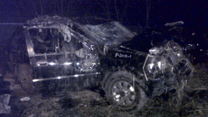This Sunday, March 10, 2013 photo shows a Honda Passport that crashed into a guardrail and flipped over into a swampy pond Sunday morning in Warren, Ohio. Highway Patrol officials say speed was a factor in the violent early morning crash of the vehicle that killed six teenagers in northeast Ohio. (AP Photo/Tom Sheeran)