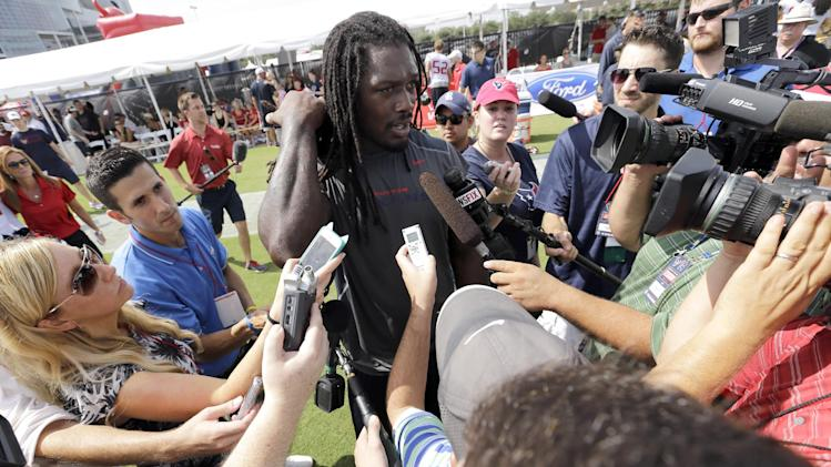 Houston Texans linebacker Jadeveon Clowney talks with members of the media after an NFL football training camp practice Saturday, July 26, 2014, in Houston
