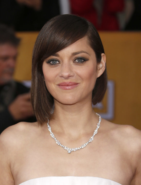 Marion Cotillard arrives at the 19th Annual Screen Actors Guild Awards at the Shrine Auditorium in Los Angeles on Sunday Jan. 27, 2013. (Photo by Todd Williamson/Invision for The Hollywood Reporter/AP