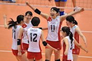 Japan&#39;s captain Erika Araki (C) and her teammates react following their point against Serbia during their women&#39;s volleyball qualifying tournament match for the London Olympics in Tokyo. South Korea, Serbia and Japan qualified for the London Olympics, joining two-time world champions Russia, on the final day of the women&#39;s volleyball qualifying tournament on Sunday