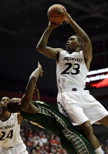 Cincinnati beats South Florida 61-53 in OT