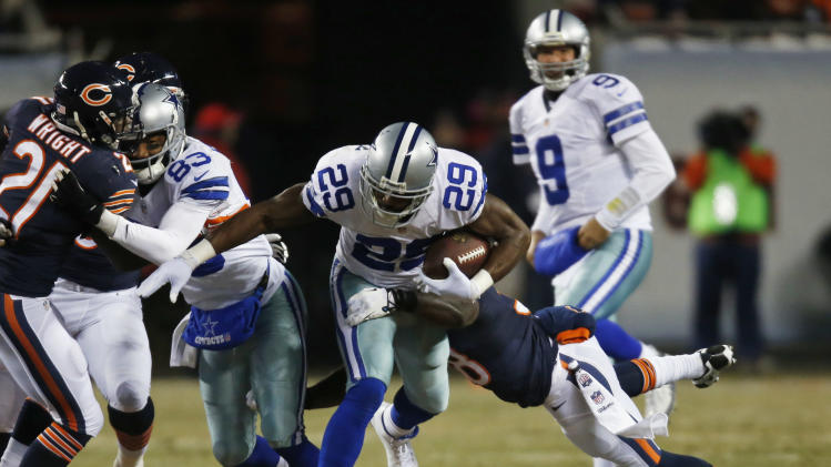 Dallas Cowboys running back DeMarco Murray (29) rushes against Chicago Bears cornerback Zack Bowman during the first half of an NFL football game, Monday, Dec. 9, 2013, in Chicago. (AP Photo/Charles Rex Arbogast)