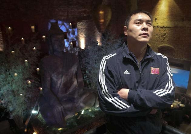 Chinese Boxer Zhang Zhilei, a 2008 Beijing Olympics silver medalist, pose during his introduction at a press conference, Monday March 10, 2014 in New York.  Zhang's introduction coincided with the