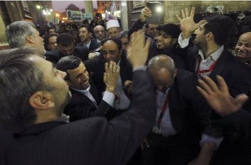 Iran's President Mahmoud Ahmadinejad meets people as he visits the Al-Hussein mosque in old Cairo