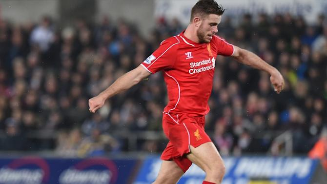 Liverpool's English midfielder Jordan Henderson (R) controls the ball before scoring during a match against Swansea City on March 16, 2015, in Swansea, south Wales