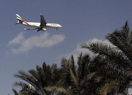 An Emirates Airlines aircraft lands at the Emirates terminal at Dubai International Airport