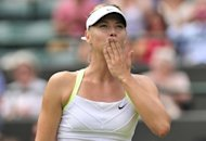 Maria Sharapova blows a kiss after her victory over Tsvetana Pironkova at Wimbledon on Thursday. Sharapova delivered a stinging rebuke to Frenchman Gilles Simon for his outspoken criticism of equal prize money by telling him: 'You'll never be as popular as me'