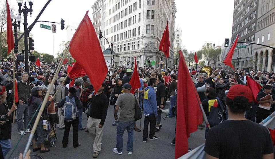 Protestors fill the intersection of 14th and Broadway during May Day protests on Tuesday, May 1, 2012 in downtown Oakland, Calif. Hundreds of activists across the U.S. joined the worldwide May Day protests on Tuesday, with Occupy Wall Street members in several cities leading demonstrations and in some cases clashing with police. (AP Photo/Ben Margot)