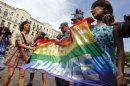 Russian police take away a banner from gay rights activists during a rally outside the mayor's office in Moscow