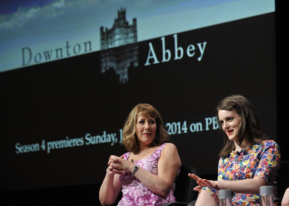 "Sophie McShera, right, and Phyllis Logan, cast members in the Masterpiece series ""Downton Abbey,"" take part in a panel discussion on the show at the PBS Summer 2013 TCA press tour at the Beverly Hilton Hotel on Tuesday, Aug. 6, 2013 in Beverly Hills, Calif. (Photo by Chris Pizzello/Invision/AP)"