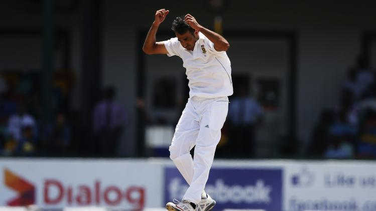 South Africa's bowler Tahir reacts after his teammate Steyn dropped a catch hit by Sri Lanka's Dickwella during the second day of their second test cricket match in Colombo