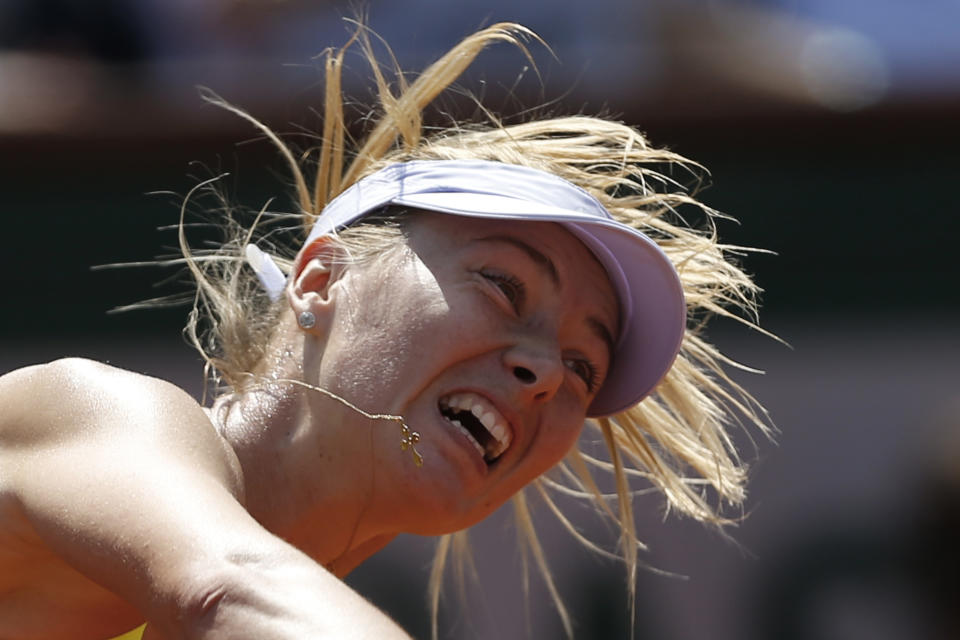 Russia's Maria Sharapova serves against Serbia's Jelena Jankovic in their quarterfinal match at the French Open tennis tournament, at Roland Garros stadium in Paris, Wednesday June 5, 2013. (AP Photo/Petr David Josek)