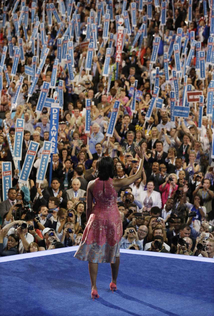 First Lady Michelle Obama waves after speaking at the Democratic National Convention in Charlotte, N.C., on Tuesday, Sept. 4, 2012. (AP Photo/Charlie Neibergall)