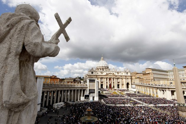 Faithful gather in St. Peter's Square at the Vatican during the Easter Mass celebrated by Pope Benedict XVI, Sunday, April 8, 2012. Pope Benedict XVI celebrated Easter Sunday Mass in sun-drenched, flo
