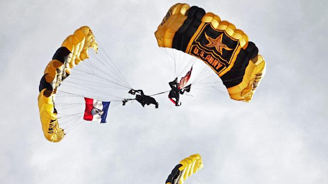 FILE - In this Tuesday, July 3, 2012 file photo, the U.S. Army Golden Knights parachute in before a baseball game between the St. Louis Cardinals and the Colorado Rockies, in St. Louis. The Golden Knights, along with theU.S Navy's Blue Angels and the U.S. Air Force's Thunderbirds, have cancelled their 2013 seasons because of the automatic federal budget cuts causing about 60 cancellations thus far and affecting more than 200 of the approximately 300 air shows held each year. (AP Photo/Tom Gannam, File)